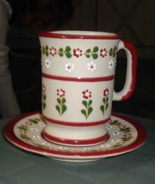 Juego de taza y plato de cerámica de alta temperatura diseños ornamentales.